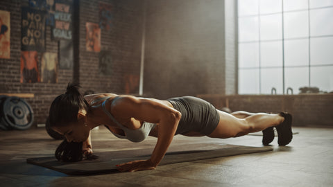 A woman doing a push up.