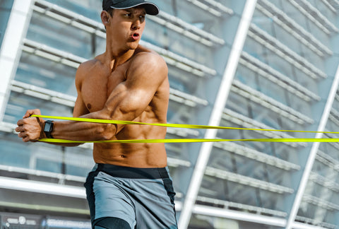 Strong man working with resistance band