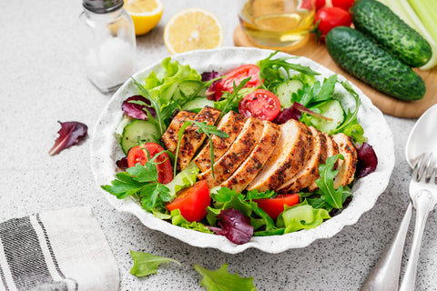 Grilled chicken breast, fillet and fresh vegetable salad