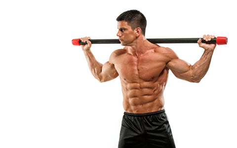 Sports Men Doing Abs Twisting Exercise With Weight Bar