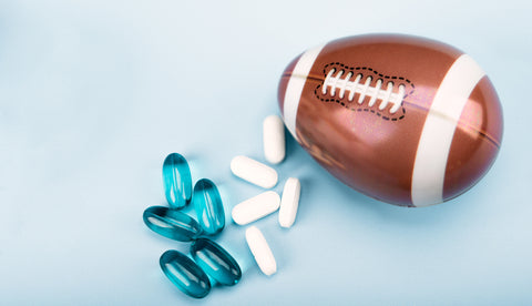 Sport equipment, Egg in the form of a football ball with medicine pills and dietary supplements