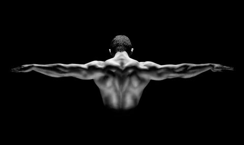 Muscular man with his arms stretched out