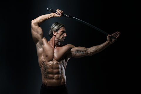 Man Holding Sword Ready To Fight