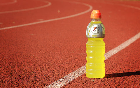 A bottle of yellow Gatorade.