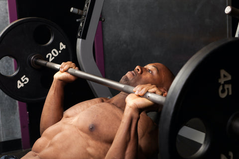 A man doing the incline barbell bench press.