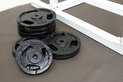 Barbells weight plate in gym room