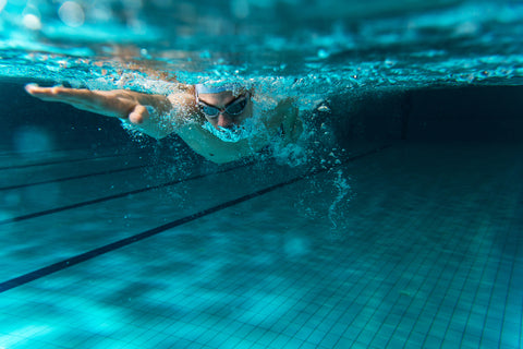 Male swimmer underwater in a swimming pool