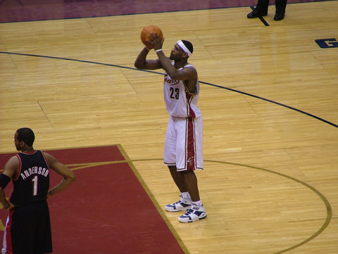 Lebron James shooting a basketball.
