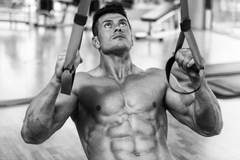 Man Does inverted rows With Trx Fitness Straps