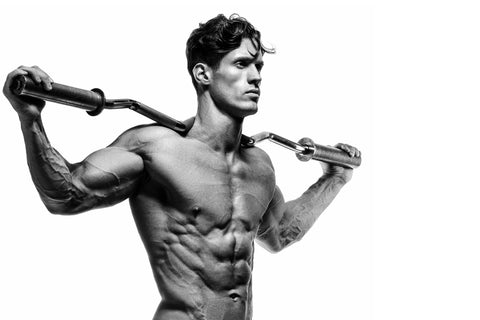 Muscular and fit young bodybuilder posing demonstrates the core muscles
