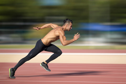 A man sprinting on a track.