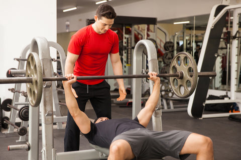 Two men working out in a gym.