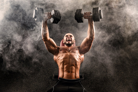 A man doing dumbbell flyes
