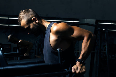 A man doing tricep dips.