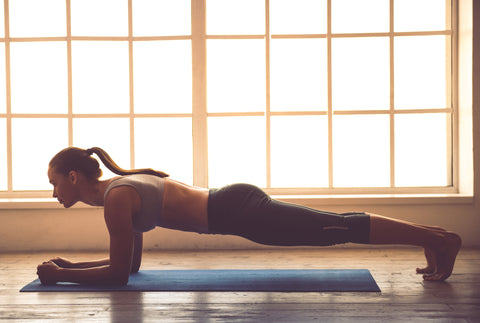 A woman doing a plank excercise.