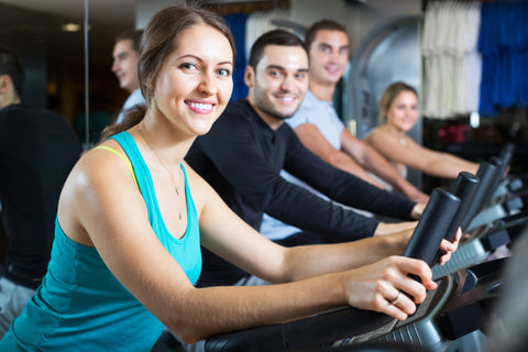 People working out on treadmills.