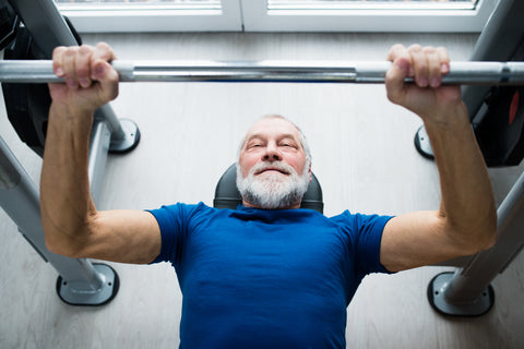 A man doing the bench press.