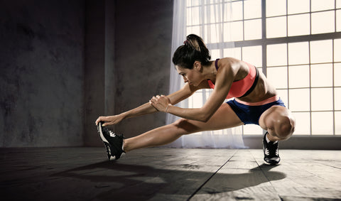 A girl stretching in a gym.