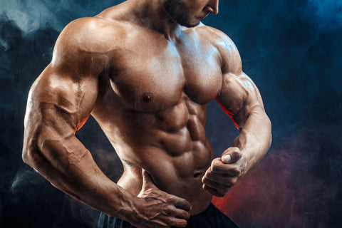 Bodybuilder man with perfect abs, shoulders,biceps, triceps and chest,