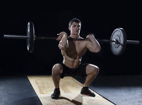 A man doing the front squat.