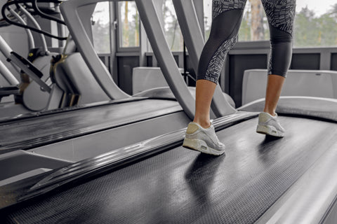 A girl walking on a treadmill.