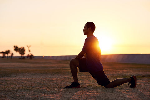 man stretching his legs outdoors