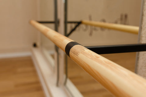 Empty workout studio with a barre