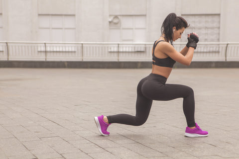 A girl doing lunges.