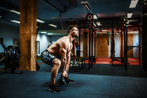 Kettlebells swing exercise bearded man workout at gym
