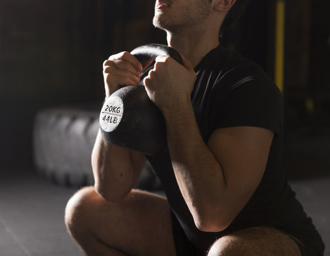 Young athlete exercising goblet squats