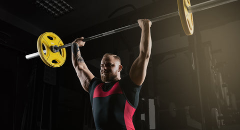 Weightlifter does an exercise with a barbell.