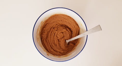 A bowl of peanut butter.