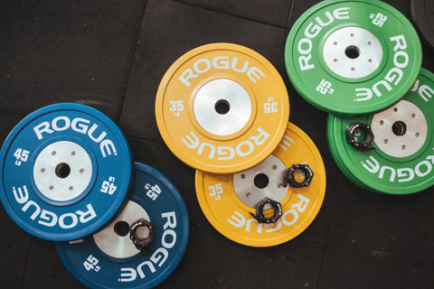 Some colorful weights on the ground.