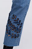 Autumn Leafs  A pair of denim skinny jeans, two back pockets, and a front and lower leaf stitch design.