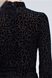 Leopard Blouses featuring an allover leopard print long sleeve choker top with peplum and waist tie.