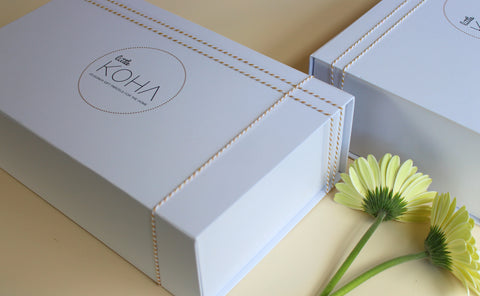 Two Little Koha boxes with flowers in a flatlay style of photography
