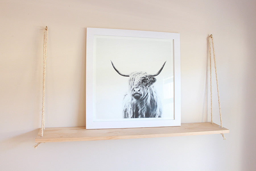 Large frame to anchor the shelf