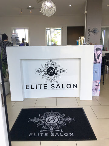 Personalised mat at business reception counter