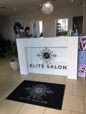 Personalised mat at entrance to hair saloon