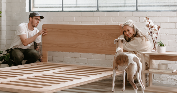 The Eva Timber Bed Frame with models and dog