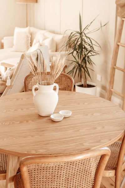 Vintage rattan chairs and timber table