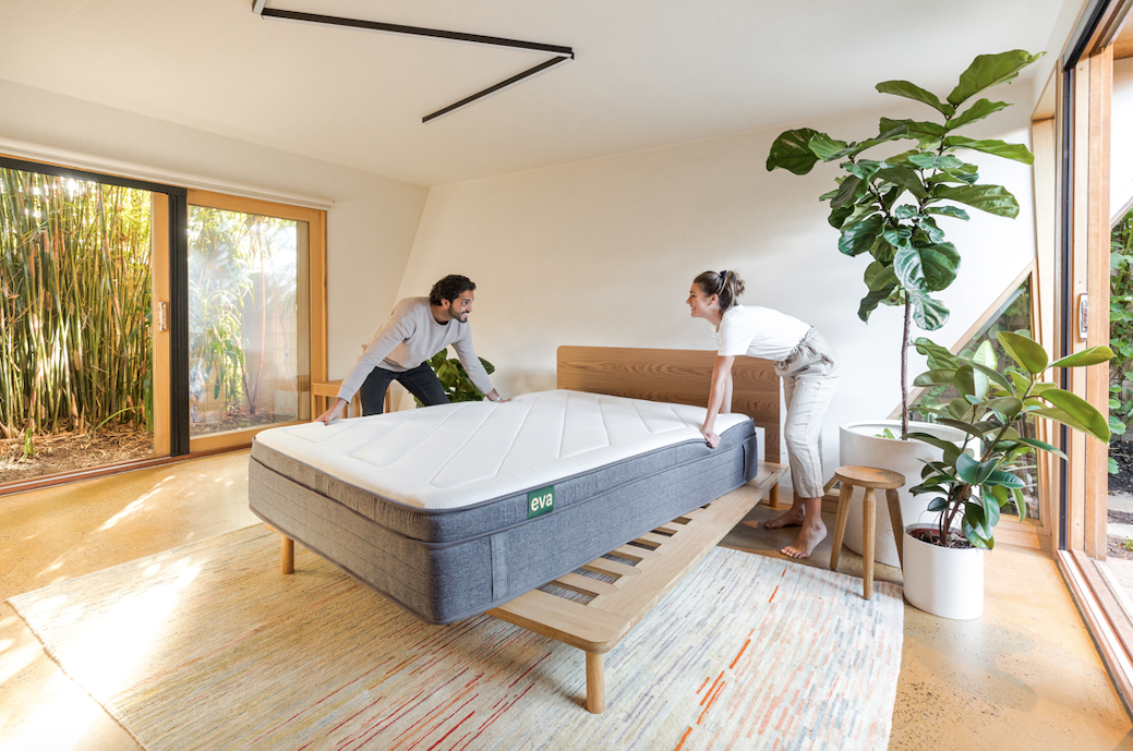 Couple with new eva mattress making the bed
