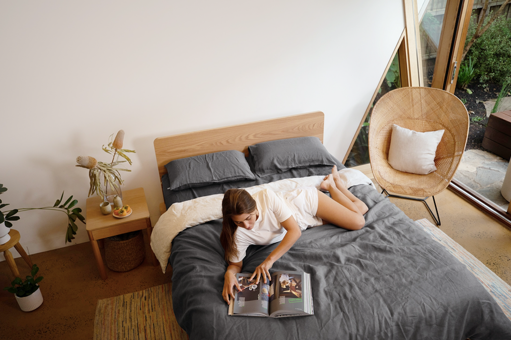 Girl laying on bed reading book