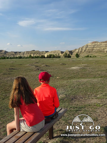 2 kids looking at a Prairie Dog Town in Theodore Roosevelt National Park