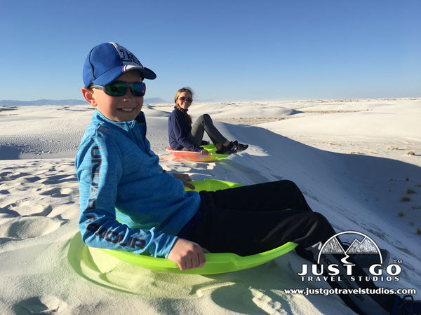 sledding in White Sands National Monument