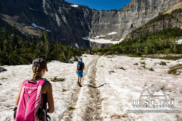 Hiking on the snow on the Iceberg Lake Trail in Glacier National Park