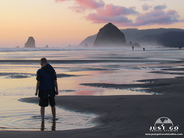 walking on the beach in Canon Beach, oregon