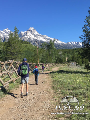 Hiking along a fence on the Taggart Lake Trail in Grand Teton National Park