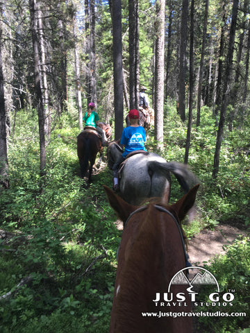 Horseback riding through the woods in Grand Teton National Park with Swift Creek Outfitters