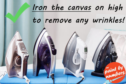 Iron and ironing board to remove wrinkles from canvas